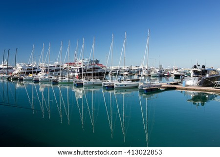 Sochi, Russia - February 9, 2016: Racing yacht in the port of Sochi on a sunny day - stock photo