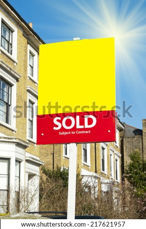 Sold Real Estate Sign and House - stock photo