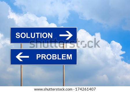 solution and problem on blue road sign with blue sky - stock photo