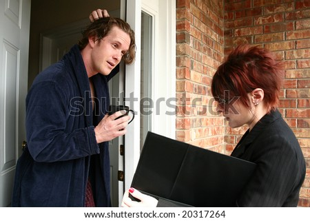 30 something man in pj's talking to sales woman at door. - stock photo