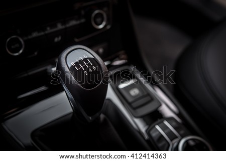 6 speed gearshift leather handle in a modern car black interior - stock photo