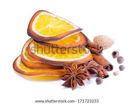 Spices,anise , cinnamon and orange segments isolated on white - stock photo