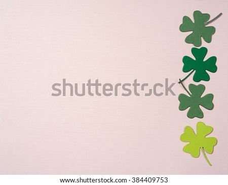 St. Patrick's Day shamrocks on paper background - stock photo