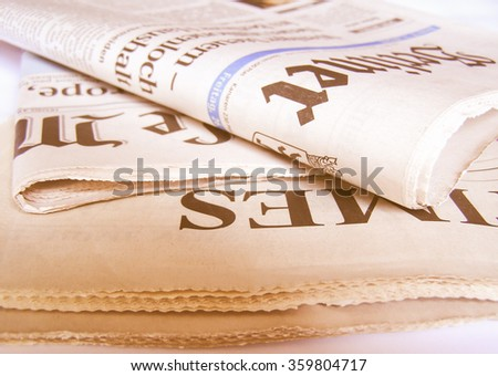 Stack of newspapers picture vintage - stock photo