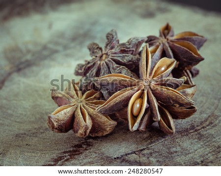 star anise on  wood background - stock photo