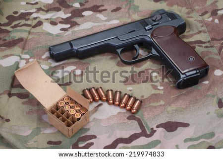 Stechkin automatic pistol APS on camouflage background - stock photo