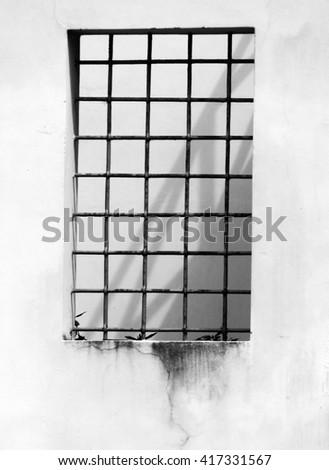 Steel bars look like a prison window                              - stock photo
