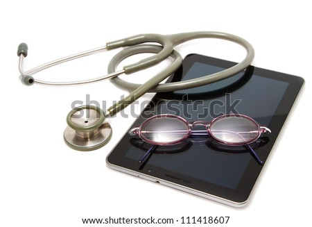 stethoscope and glasses rest on tablet ,for modern diagnostic - stock photo