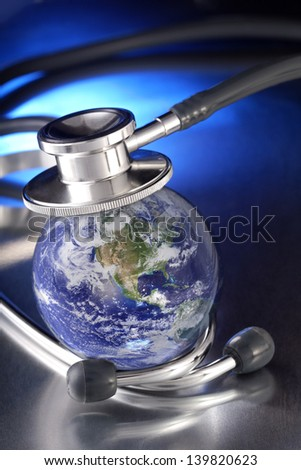 stethoscope on earth  (Collage images from NASA site) - stock photo