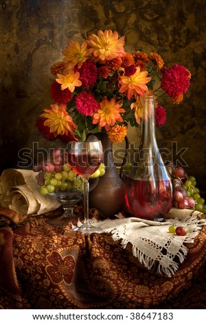 Still life with autumn flowers, grapes and wine - stock photo