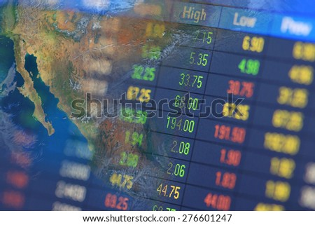 stock chart analysis on monitor,including elements furnished by NASA - stock photo