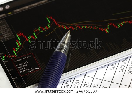 stock chart and smartphone, investment background, businessman using a mobile phone to check stock market data and data paper document. - stock photo