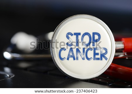 Stop cancer and stethoscope. Stop cancer sign and stethoscope. Medicine concept on computer keyboards - stock photo