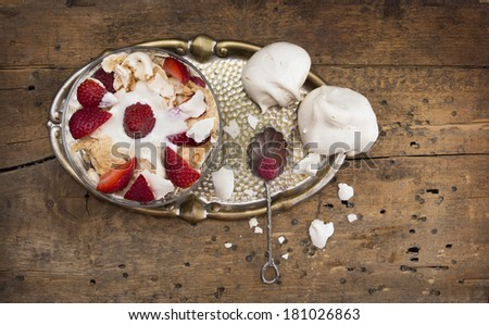 strawberries, meringue and mascarpone  in glass bowl on old Metal tray, wooden table - stock photo