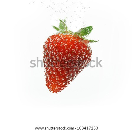 Strawberry in water - stock photo