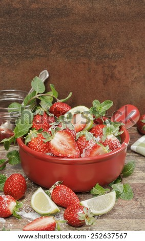 Strawberry jam. Making strawberry jam,  stirring strawberries and sugar and fresh fruits on a background of rustic  wood. Macro, selective focus - stock photo