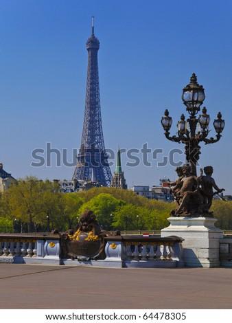 Street lantern on the Alexandre III Bridge against the Eiffel Tower in Paris, France. - stock photo