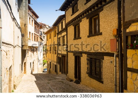 street with typical houses in Frias. Burgos, Spain - stock photo