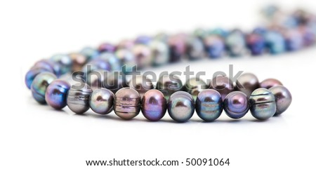 String of pearls over white - stock photo