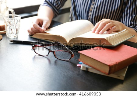 student open book and reading ,hand writing pen on paper page,hardworking for achievement business target concept, reading book for knowledge concept.  - stock photo