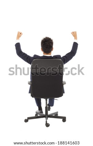 successful businessman with hands up - stock photo