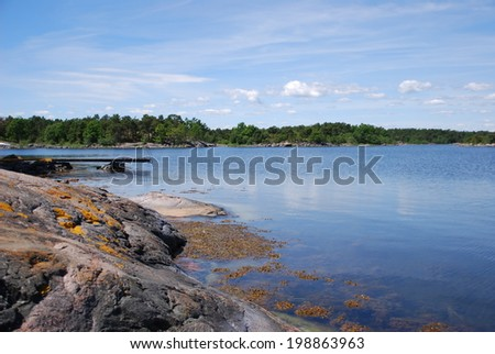 Summer idyll on a lonely Swedish fjord  - stock photo