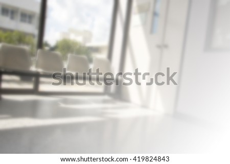 Sun light in window of blurred background space, Hospital waiting room with empty white chairs. - stock photo