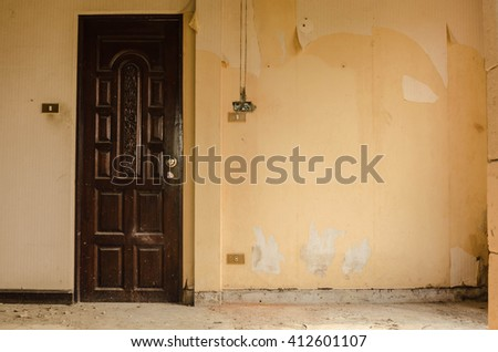 Sunlight is falling through an empty room of an old, deserted b - stock photo