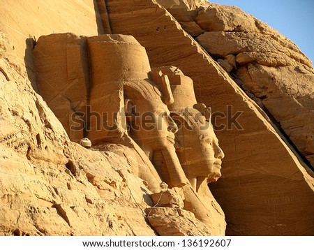 Sunrise in Abu Simbel and Rameses II in  Abu Simbel - stock photo