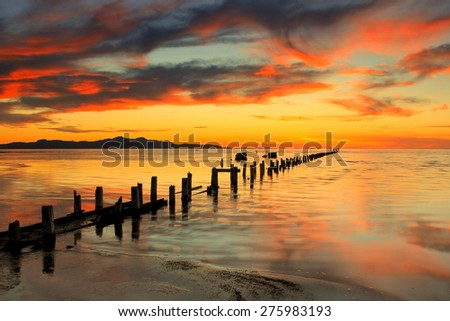Sunset at an old pipeline in the Great Salt Lake, Utah, USA. - stock photo