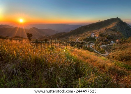 Sunset in the mountains landscape,Doi Pha Tung,Chiangrai province ,North of Thailand. - stock photo