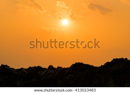 sunset over the silhouette mountain hills - stock photo