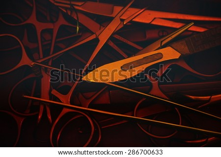surgical instrument in iodine solution chamber - stock photo