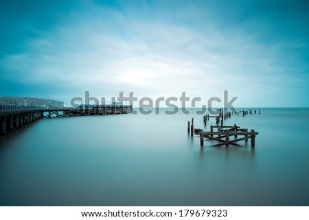 Swanage The ruined old pier at Swanage, Dorset - stock photo