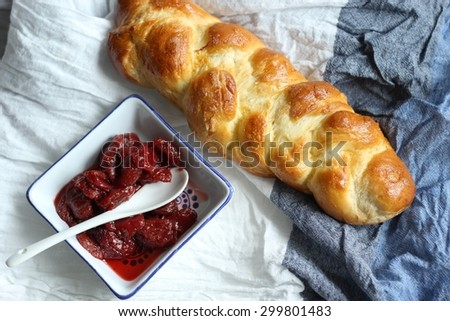 sweet breakfast - challah and strawberry jam/  sweet breakfast - challah and strawberry jam - stock photo