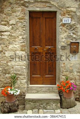 sweet italian entrance flowery with colorful impatiens, Tuscany - stock photo