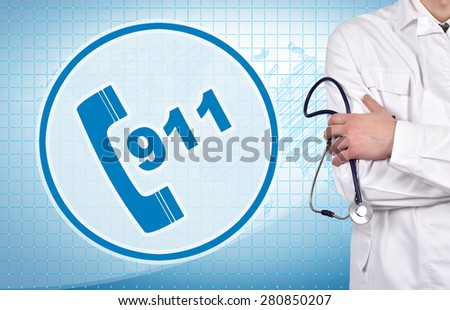 911 symbol and young doctor holding stethoscope - stock photo