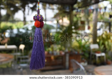 tassel hanging from rope - stock photo