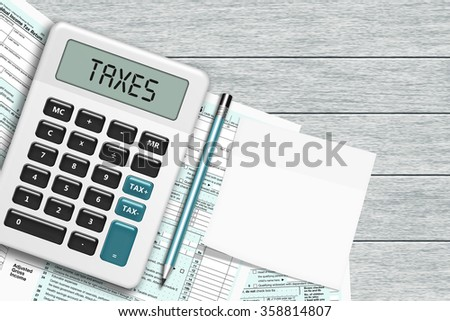 1040 tax form with calculator and note lying on wooden desk with place for text - stock photo
