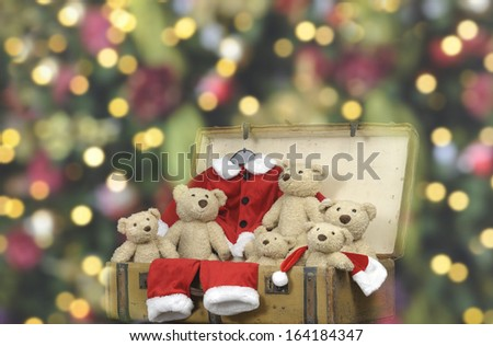 teddy bears in a vintage suitcase - stock photo