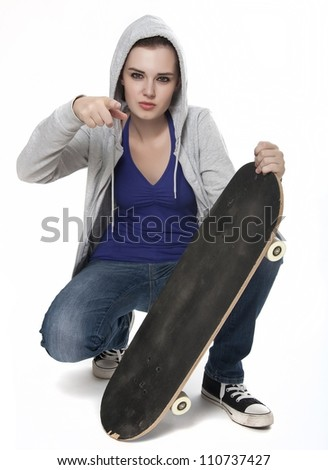 teenager girl with skateboard - stock photo