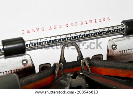"""Terms And Conditions"" on an old typewriter in genuine typescript. - stock photo"