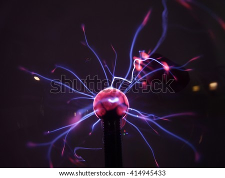 Tesla coil - physics experiment for children   - stock photo