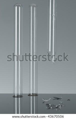 3 test tubes, one broken - stock photo