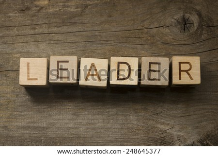 text Leader on a wooden background - stock photo