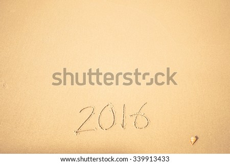 2016 text on the beach for new year concept background - stock photo
