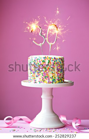 30th birthday cake with sparklers - stock photo