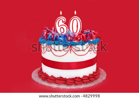 60th cake, with numeral candles, on vibrant red background. - stock photo