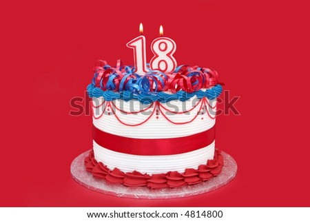18th cake, with numeral candles, on vibrant red background.  A special birthday. - stock photo