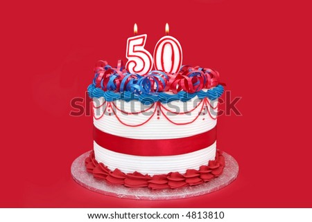 50th cake, with numeral candles, on vibrant red background.  Birthday, anniversary, etc. - stock photo